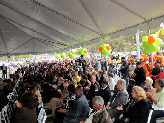 A large crowd attended the ceremony, including many from the building trades hoping to build the project.
