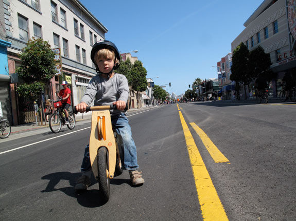 A child riding a balance bike during Sunday Streets in 2009. Photo: Matthew Roth