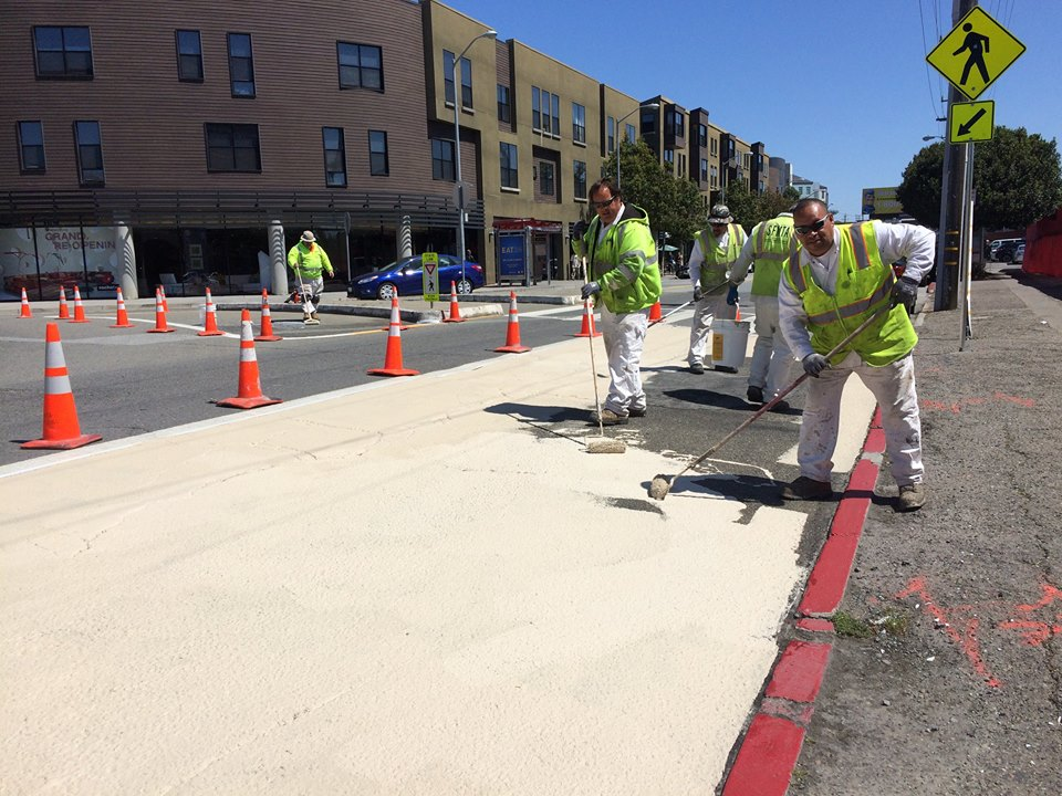 SFMTA crews install painted curb extensions today at the traffic circle at Eighth and Division Streets. Photo: SFMTA Livable Streets/Facebook