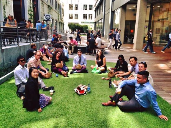 City transportation staffers enjoy the astroturfed plaza created on the Stevenson Street alley as part of the Twitter building's renovation. Photo: Jessica Kuo