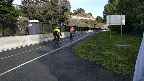 Although it will be another __ until the train reaches Larkspur, the adjacent bike path is open now.