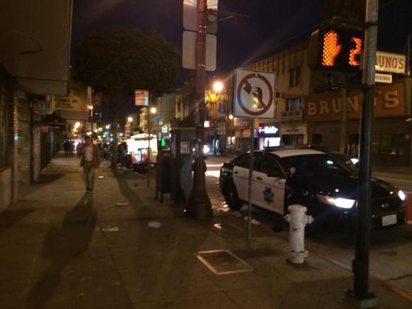 The perp/suspect is in the back of the SFPD car. Photo: Solis.