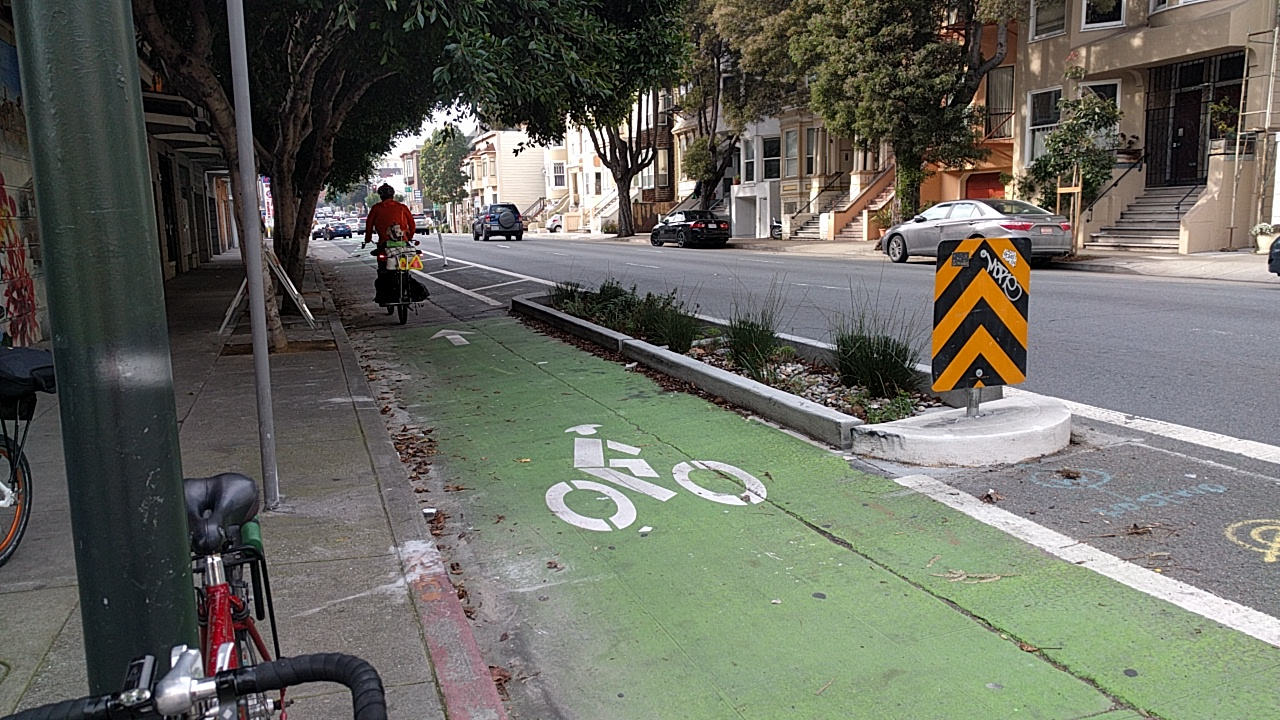 A rare bike lane without a car in it. Could it have something to do with the concrete divider? Photo: Streetsblog.