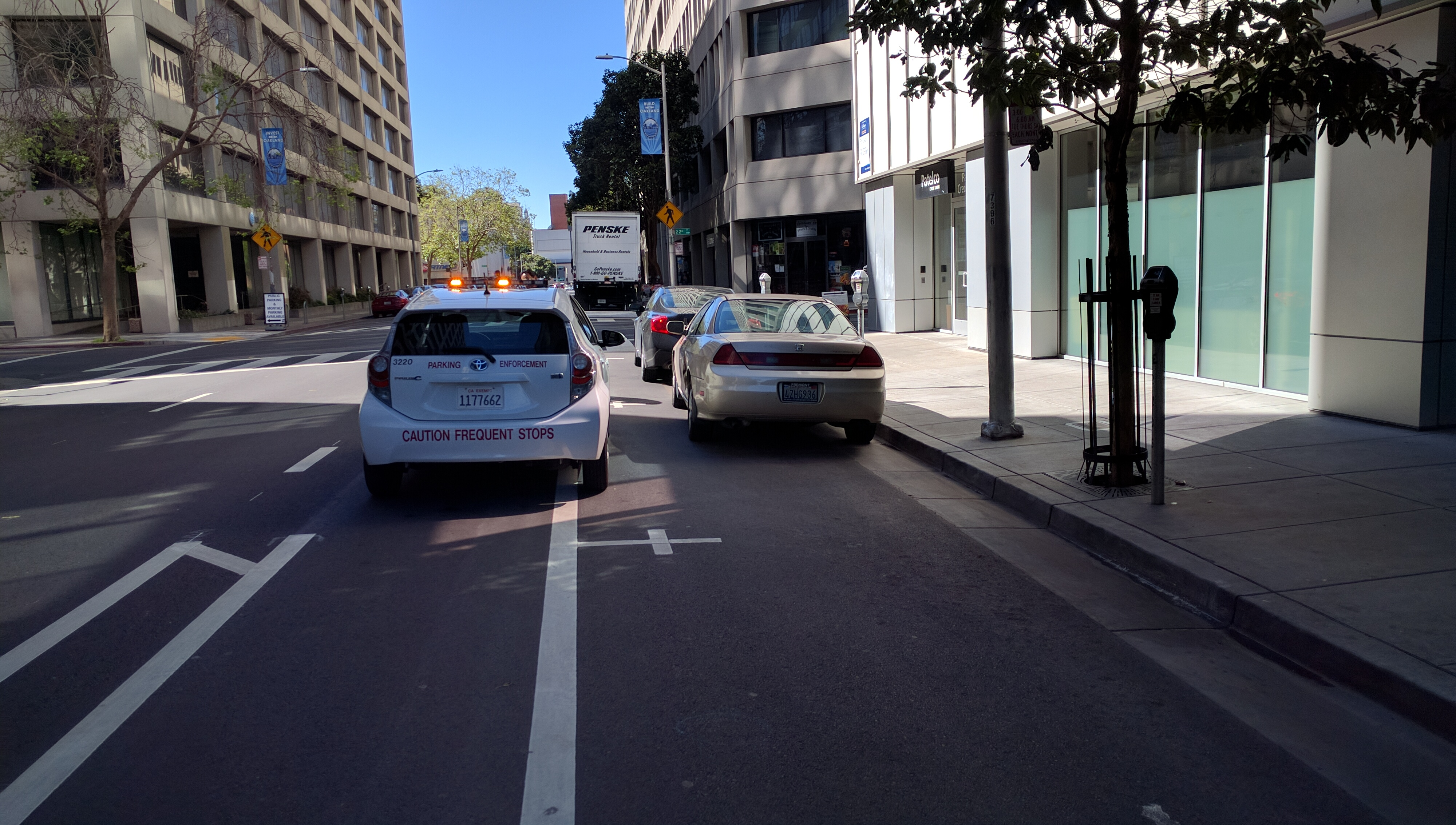 Some people say we just need better parking enforcement to keep Oakland's Webster Street Bike lane clear, but Streetsblog isn't so sure. Photo: Streetsblog.