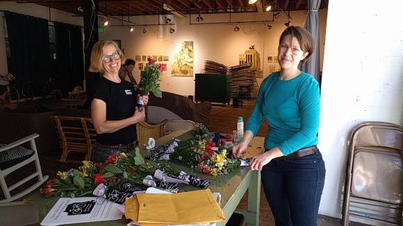 Lauren Sailor and Devon Warner preparing flowers for cyclists killed in San Francisco. Photo: Streetsblog.