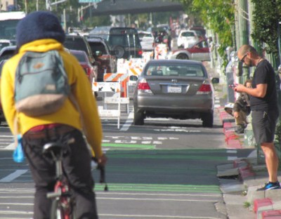 Unfortunately it is very easy to get pictures of cars parked in the new bike lanes. Photo: Melanie Curry/Streetsblog
