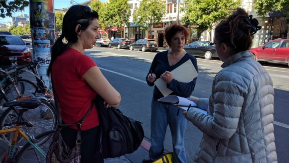 Volunteer advocates Natalie Angouleme and Maureen Persico take instructions from Catherine Orland before going out to count cars on bike lanes. Photo: Streetsblog.