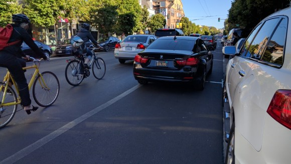 One of some 50 cars that blocked the bike lane on one side of Valencia between 16th and 17th at the peak hour Tuesday night. Photo: Streetsblog.