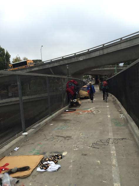 Even once they decamp, the homeless end up leaving trash on the bridge. Photo: Dan Crosby.