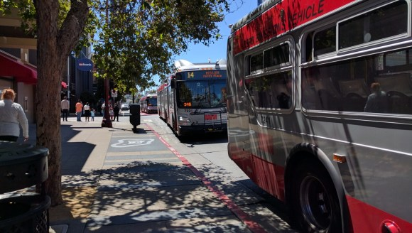 One thing the transit lanes doesn't seem to have improved on: bus bunching. Three 14s in a row pulled into the stop on 22nd. Photo: Streetsblog.