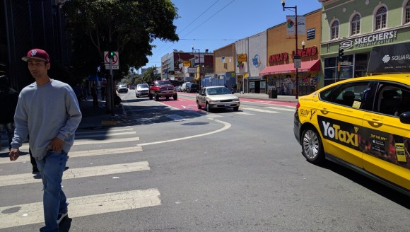 Private cars follow a cab north on Mission instead of turning right as is currently required. Photo: Streetsblog.