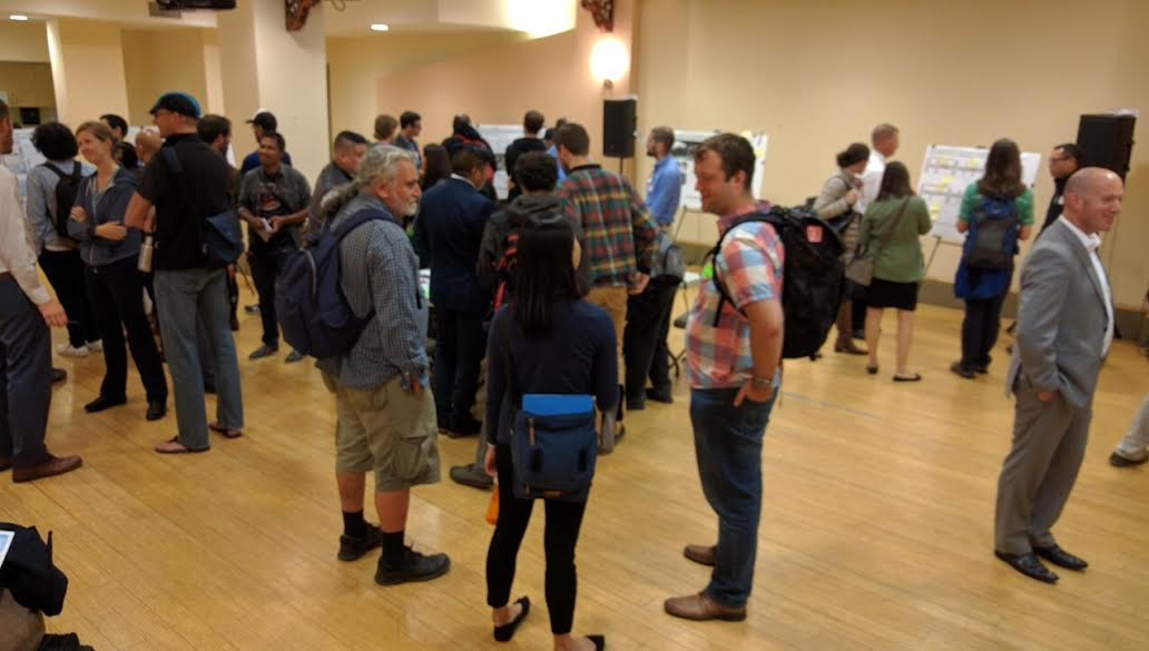 Some 45 people showed up to learn about planned protected bike lanes on 7th and 8th. That's SFMTA's Mike Salaberry on the right in the gray suit. Photo: Streetsblog