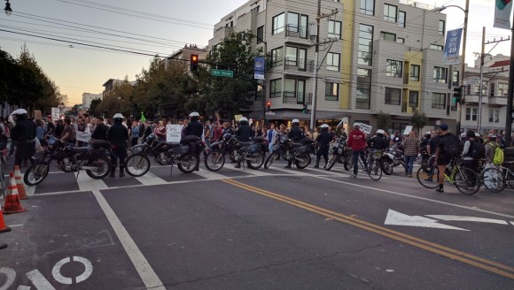 Back to today's sad reality. Later that evening, after Sunday Streets, an anti-Trump demonstration crosses Valencia at 16th Street. Photo: Streetsblog