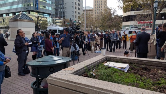 The press gaggle watched from Frank H. Ogawa Plaza, in front of Oakland City Hall. Photo: Streetsblog