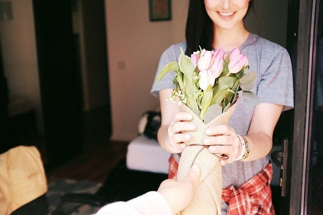 Image result for man giving woman flowers
