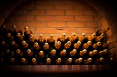 BXNYX2 wine cellar door shows display of wine and champagne bottles