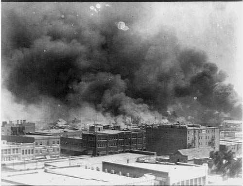 ' ' from the web at 'https://i2.wp.com/sfbayview.com/wp-content/uploads/2011/02/Tulsa-Race-Riot-Black-Wall-Street-on-fire-060121.jpg'