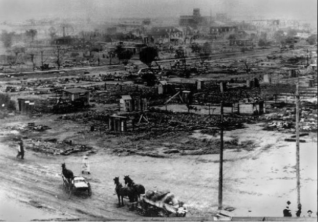' ' from the web at 'https://i2.wp.com/sfbayview.com/wp-content/uploads/2011/02/Tulsa-Race-Riot-Greenwood-destroyed-060121.jpg'