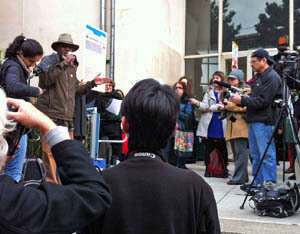 Save City College rally Tarik Farrar at mic outside Diego Rivera Theater, where chancellor was speaking by Bob Price, Fr