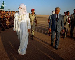 Muammar Qaddafi inspects troops wearing traditional Tuareg dress