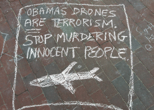 'Obama's drones ARE terrorism' sidewalk chalk sign