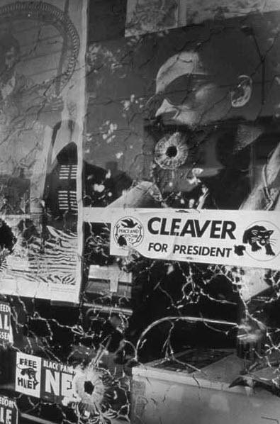 Black Panthers- Window of BPP HQ w bullet holes by Pirkle Jones