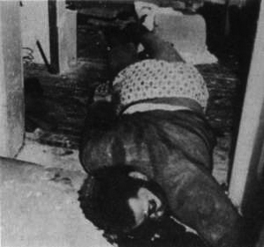 Ch. Fred Hampton assassinated, dragged by wrist to doorway 120469