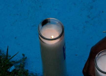 Alan Blueford 1st year memorial lit candle at nightfall 050513 by Malaika