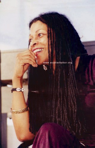 Assata Shakur, braids, smiling