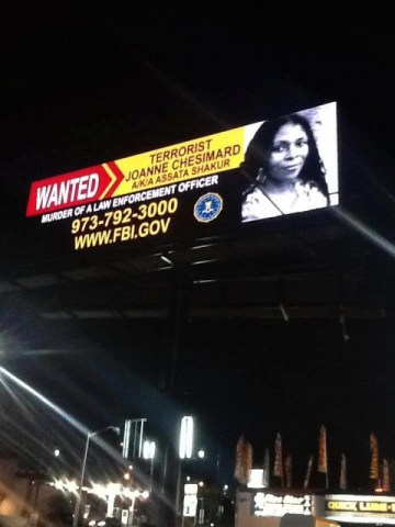 New Jersey billboard erected night before FBI announcement Assata Shakur 050213