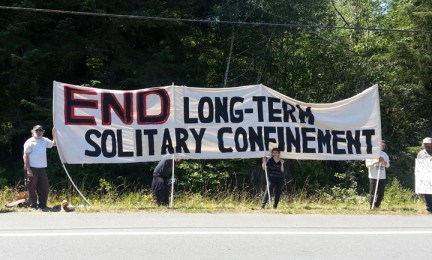 Humboldt protesters' banner 'End Long-Term Solitary Confinement' outside Pelican Bay prison 070813 courtesy PHSS Humboldt