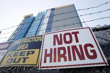 GÇÿNot hiringGÇÖ sign construction site New Orleans by Patrick Semansky, AP