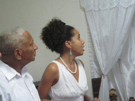 Richmond Regla Cuba Tour Ernesto Valdez Janet, niece Janet praise Orishas, Regla 1213 courtesy Marilyn Langlois, web