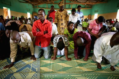 People gather at the Chapel Mbeyo in Mbeyo, Rwanda, on April 6, 2014, the eve of the 20th anniversary of the 1994 genocide. – Photo: Chip Somodevilla, Miami Herald