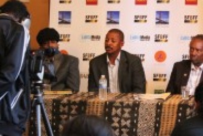 Renowned filmmaker Robert Townsend, seated between Kali O'Ray and Jac Taliaferro, is interviewed at the 2012 San Francisco Black Film Festival.