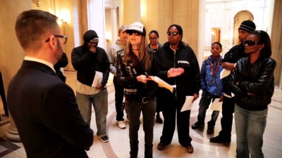 Lisa Gray-Garcia (Tiny of Poor, center) and other supporters accompanied Sabrina Carter and her sons (right) to the San Francisco Mayor's Office to protest the racist and wrongful eviction of her family from Plaza East. – Photo: Poor News Network