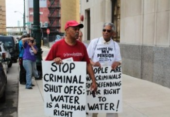"""Every week, as some 3,000 additional families' water is shut off by their """"public"""" utility, Detroiters protest on Freedom Friday. – Photo: Ryan Felton"""