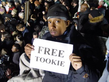 For the first time, on the night Gov. Arnold Schwarzenegger executed his old body-building competitor, author Stanley Tookie Williams, on Dec. 13, 2005, a huge crowd, largely Black youth, rallied outside San Quentin's gate in opposition, vastly outnumbering death penalty supporters. A month later, Clarence Ray Allen was executed, but since then, public and legal pressure has, in California, held off the blasphemous act of killing in the name of God. – Photo: Minister of Information JR Valrey