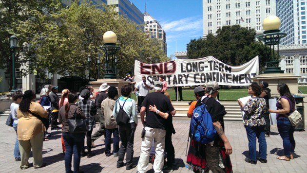 Last year's banner was unfurled again for the first of two hunger strike first anniversary commemoration events in Oakland on July 8. It was held in Oscar Grant Plaza outside City Hall from 11:30 a.m. to 1 p.m.