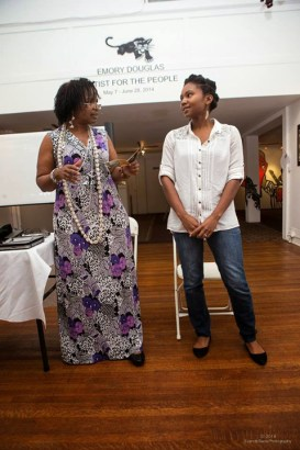 "Wanda and daughter TaSin Sabir discuss TaSin's new book, ""Madagascar Made,"" during the book release party June 29 at the Joyce Gordon Gallery. – Photo: Everett Bass"