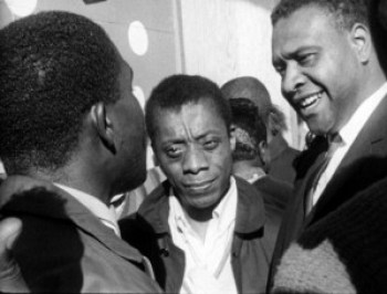 """James Baldwin and Orville Luster speak with youths in """"Take This Hammer"""" in 1963. The young people's complaints about San Francisco's progressive veneer covering racism as virulent as in the South are remarkably similar to those voiced by Black youth today. This film is a must-see for the city's entire Black community."""
