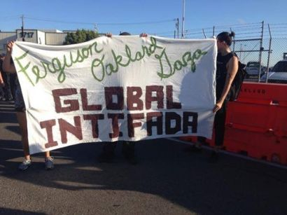 Oakland, rallying in solidarity with Ferguson and Gaza, calls for a global Intifada.