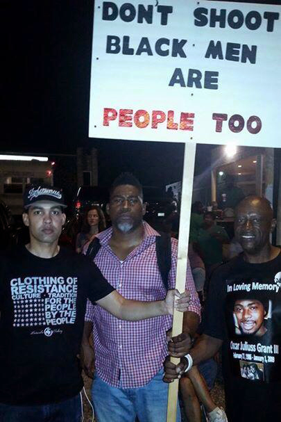 "Pittsburgh rapper Jasiri X, who traveled to Ferguson at the behest of Harry Belafonte, stands with David Banner and Cephus Johnson, Oscar Grant's Uncle Bobby. After Michael Brown's funeral, Jasiri noted: ""There were all these calls for no rioting and no looting, but not one call for the arrest of Officer Wilson. We filled that church because of Officer Wilson's action,"" he said. ""We wouldn't have been there if not for Darren Wilson."""