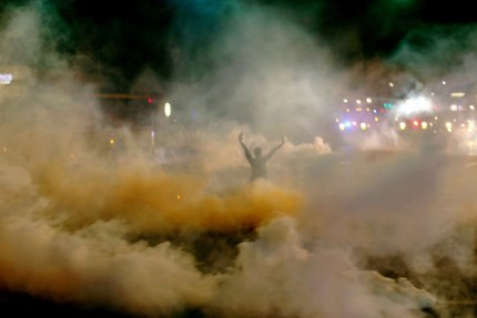 A young rebel, hands up, faces police he can't see as he wades through a river of teargas. The youth of Ferguson are undeterred in the face of the most extreme police terrorism in memory.