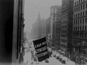 A banner announcing a lynching flies from a window of the NAACP headquarters in New York City, 1936. Since the organization's founding in 1909, the NAACP drew attention to every one of the thousands of lynchings occurring in the U.S. – Photo: NAACP