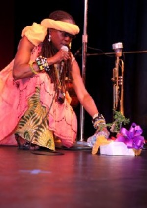 Djialli (griot) Phavia Kugichagulia opened the show with libations poured into the bonsai tree that Public Defender Jeff Adachi gave to Dr. Ratcliff as a birthday gift. Kugichagulia, who performed with her ensemble Ma'at – Alton McGriff, Ron Williams and Val Serrant – plays several instruments but most mightily the trumpet that waits in the background. – Photo: Malaika Kambon