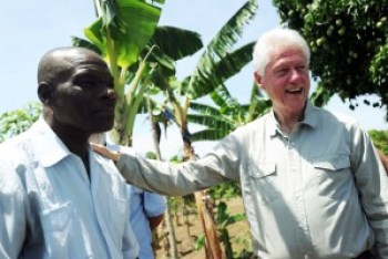 "Proud of his ""development"" of an export economy – raising food for the world but none for the Haitian people – Bill Clinton visits a peanut plantation on Haiti's central plateau on June 29, 2014. – Photo: AFP"