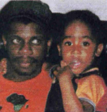 Dr  Mutulu Shakur holds his stepson  Tupac Shakur Mutulu Shakur