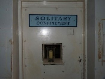 This door to the solitary confinement unit in a Pennsylvania prison looks like the door to hell. Mice are protected by federal guidelines from suffering the torture of solitary confinement – but not people.