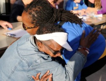 Jovanka shares a big hug with longtime Richmond resident Miss Betty. Most Richmond residents can easily identify with Jovanka, whether they are Black, Latino/a or lesbian. She is all that – and progressive. – Photo: Malaika Kambon
